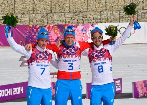 Russian skiers celebrate a sweep in the 50km. (GEPA/Ross Burton)