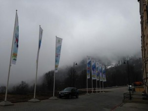 Fog clung to the mountains above Sochi on Monday, causing postponements  and cancellations. (Geoff Mintz)