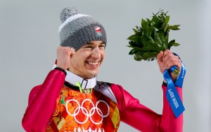 Kamil Stoch of Poland celebrates a rare Olympic ski jumping double. (GEPA/Andreas Pranter)