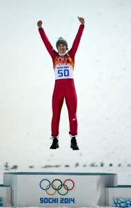The kid's got ups: Kamil Stoch celebrates Poland's first gold medal since '72.