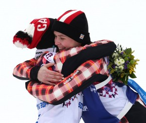 Kelsey Serwa, left, and Marielle Thompson embrace after going 1-2 for Canada in ski cross. (GEPA/Daniel Goetzhaber)