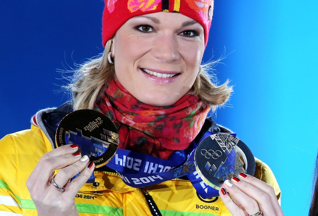 Maria Hoefl-Riesch poses with her two Olympic medals in Sochi. GEPA/Mario Kneisl