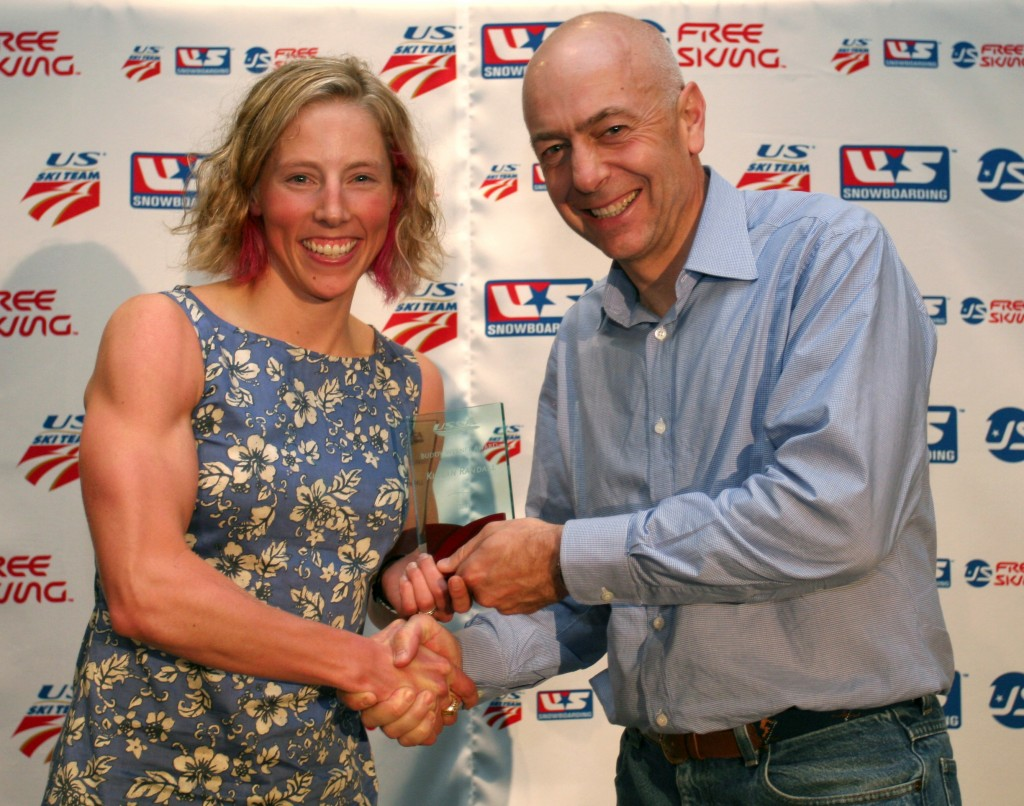 Dexter Paine presents Kikkan Randall with the 2011 USSA Cross-Country Skier of the Year Award. Sarah Ely/USSA