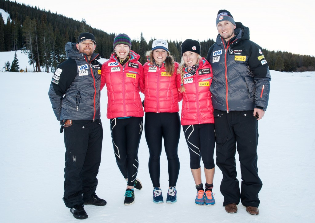 Seth McCadam (far left) poses with the U.S. Ski Team women's development squad. USSA
