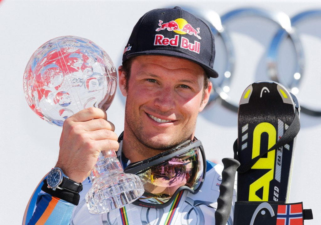 Aksel Lund Svindal with the 2014 super G globe in Lenzerheide.