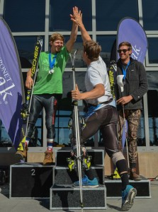 Roberts gives Robby a high five on the podium. Coronet Peak