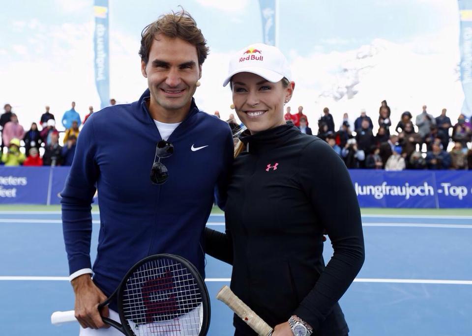 Lindsey Vonn poses with Roger Federer during a Lindt promotional event. Facebook